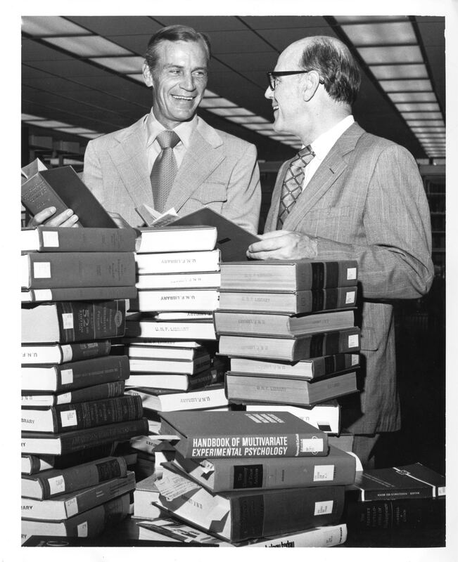 President Carpenter reviewing initial library books, with Board of Regents member Robert Mautz in 1972.