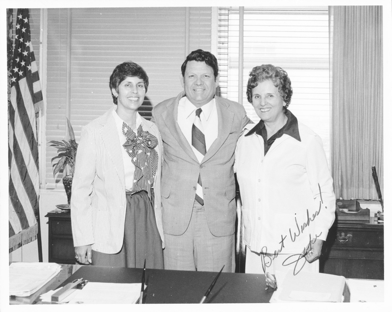 A photograph including Dr. Edna L. Saffy, Mayor Jake Godbold, and one other. Handwritten inscription: Best Wishes! Jake